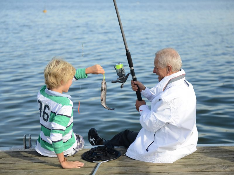 Caucasian grandfather and grandson fishing